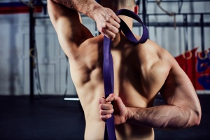 Closeup of young man during mobility exercise stretching arms w
